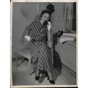 1948 Press Photo Woman using a telephone