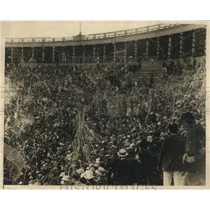 1925 Photo confetti fight Harvard Stadium between grads and undergrads