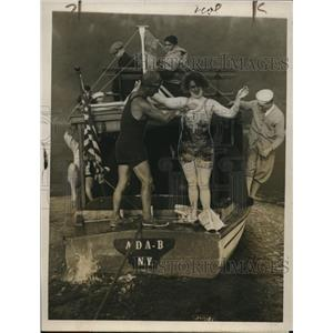 1926 Photo Charlotte Schommel getting greased by trainer Harry Seixas