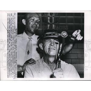 1955 Press Photo Optometrist Checks Vision of Redleg Players Cincinnati
