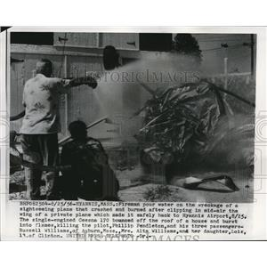 1956 Press Photo Firemen pour water on wreckage of sightseeing plane - nee28601