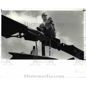 1991 Press Photo James Siebenaler Atop Cobra AH-1S Helicopter at Air Show
