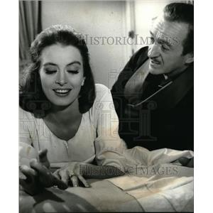1964 Press Photo David Niven and Capucine in Colorful Comedy The Pink Panther.