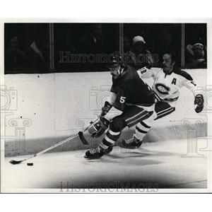1955 Press Photo Denis Potvin vs Yuan Cournoya at hockey game - nes45514
