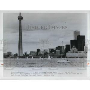 1976 Press Photo Skyline of Toronto Canada looming above Lake Ontario.