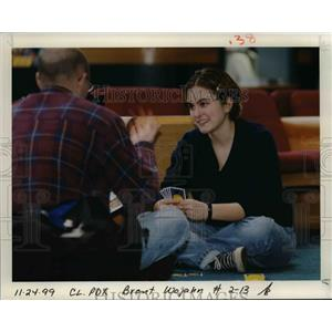 1999 Press Photo Waiting and playing at Portland International Airport