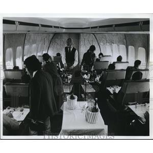 1976 Press Photo After preparations are made in galley, attendants serve meal