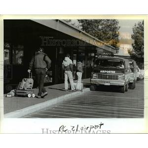 1988 Press Photo Passengers wait at Portland international Airport - orb36597