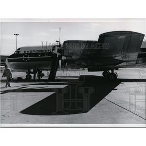 1978 Press Photo Evergreen Airline's 94-seat Electra lands with one passenger.