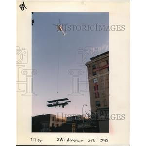 1995 Press Photo Helicopter carries a biplane - orb04201