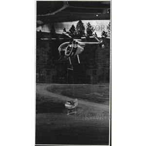 1988 Press Photo Helicopter seeds a patch of ground in Hangman Hills area