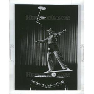 1942 Press Photo A young woman twirls table plates - RRR78231