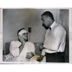 1957 Press Photo Boston Bruins Defenseman Injured in Black Hawks' Game