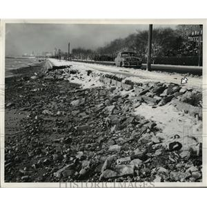 1951 Press Photo A portion of sidewalk eroded away by the waves at Lake Michigan