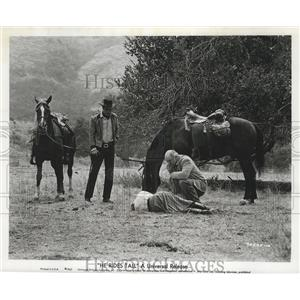 """1963 Press Photo Tony Young and R.G. Armstrong in the film """"He Rides Tall"""""""