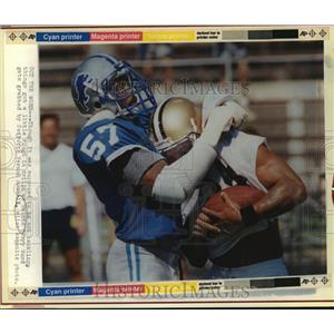 1988 Press Photo New Orleans Saints- Saints Barry Word grabbed by Vernon Maxwell