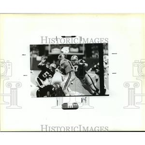 1988 Press Photo New Orleans Saints- Saints and Cardinals on the field/