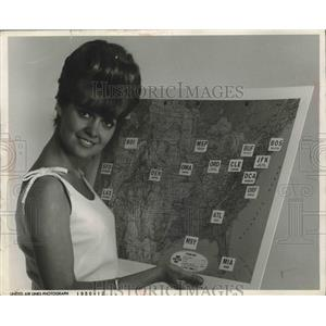 1966 Press Photo Karen Van Ort of United Air Lines' Displays Map of Routes